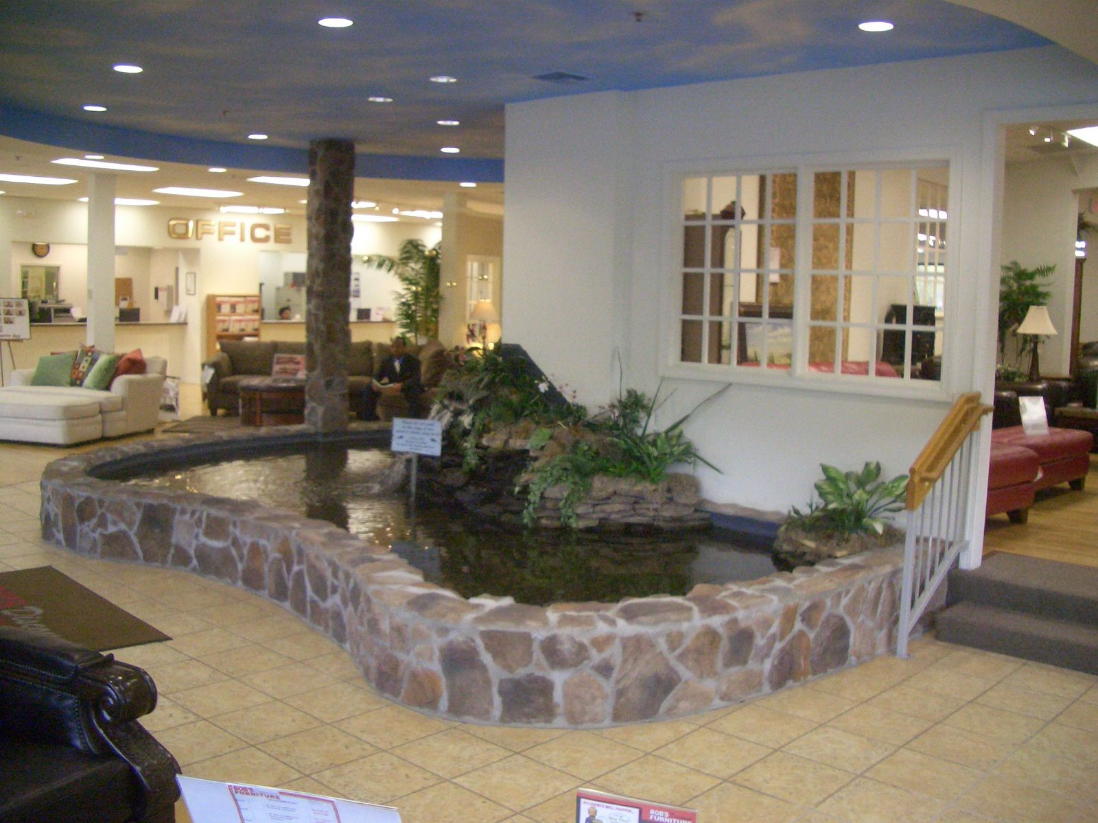 Indoor ponds custom fiberglass koi pond at commercial for Fish furniture outlet