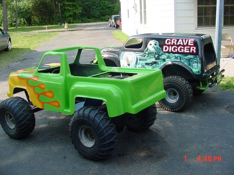 here are my kids mini monster truck go kart grave digger taz
