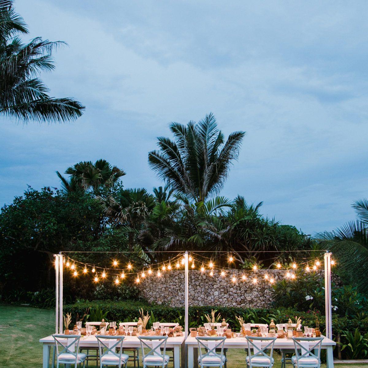 Bali Wedding ideas   Long table tropical lush foliage   Hanging globes