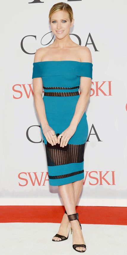 Brittany Snow in a bright blue dress.