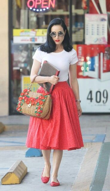 Dita von Teese. New Look silhouette with a t-shirt and colorful skirt. And flats.