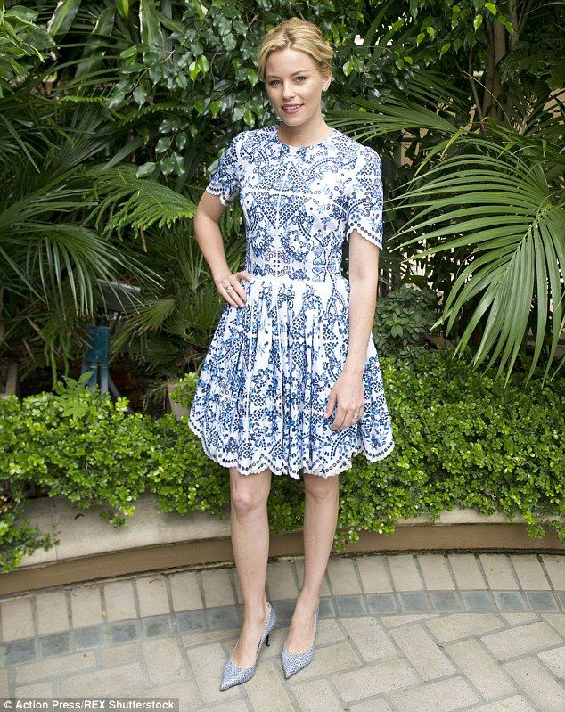 5b9b20b5a20e Blue morning  Elizabeth Banks made a pretty picture while wearing a blue  paisley print dre.