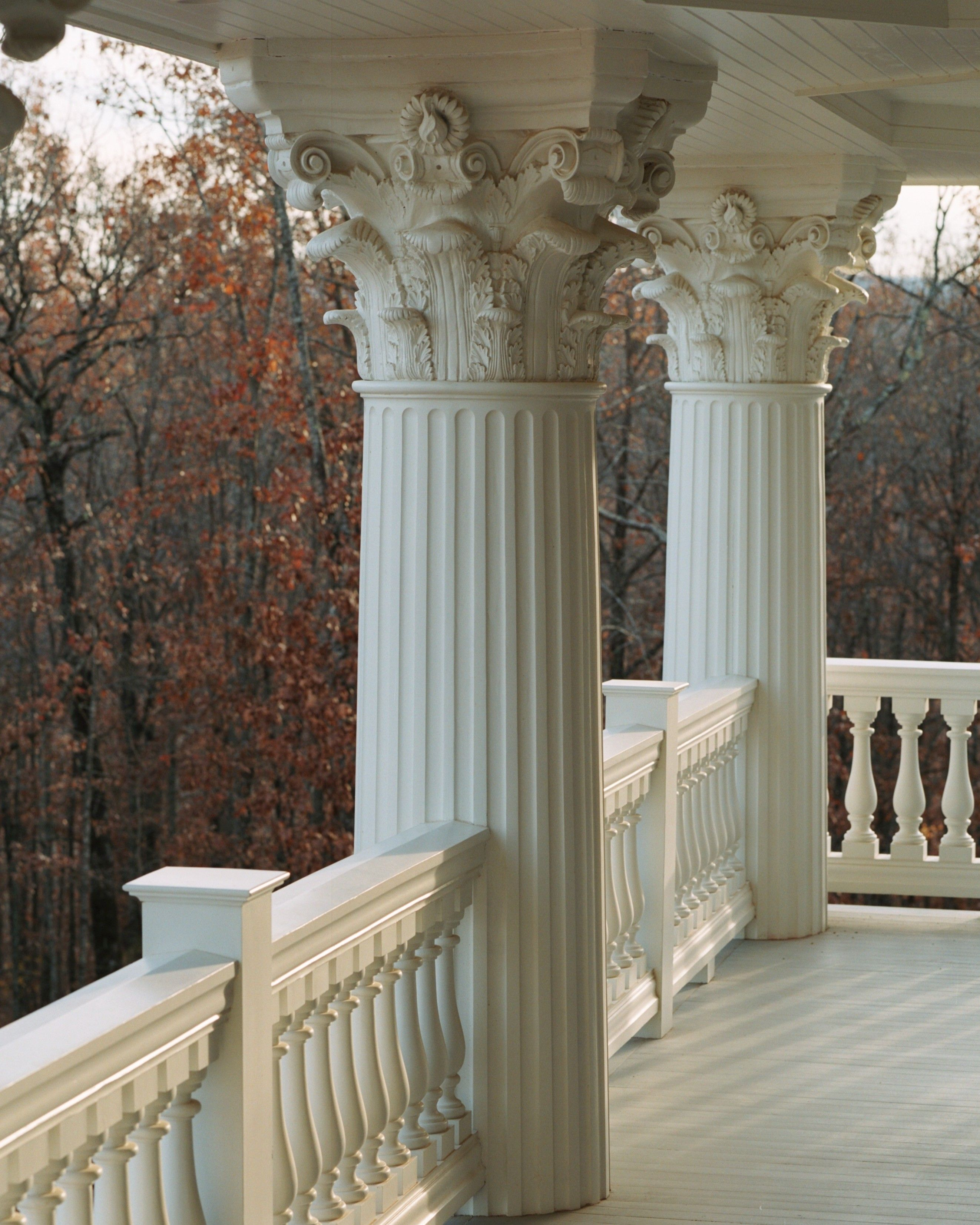 Exterior Columns Cost: Porch With Large Round Fluted Columns With Decorative Caps