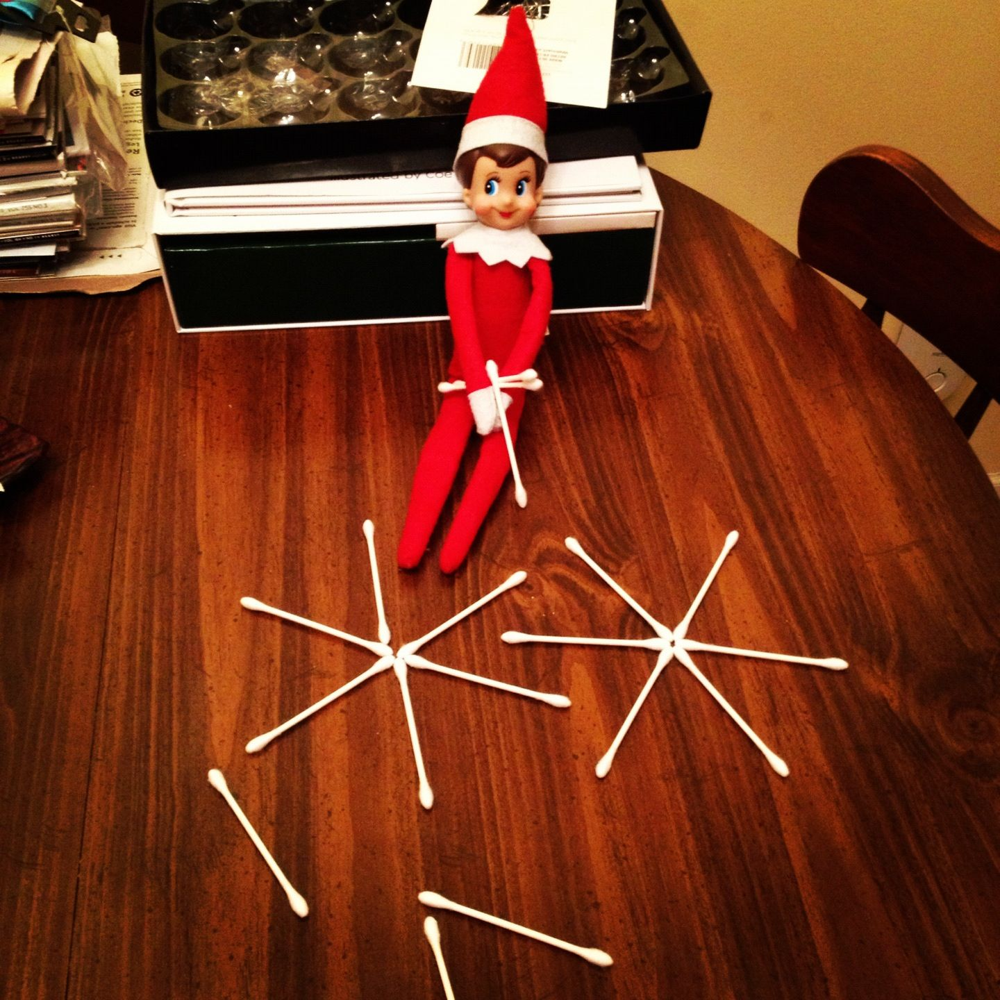 Day 10 12 10 12 Ellie The Elf In The Kitchen Making Snowflakes Out Of Q Tips Haha Elfontheshelf Holiday Decor The Elf Decor