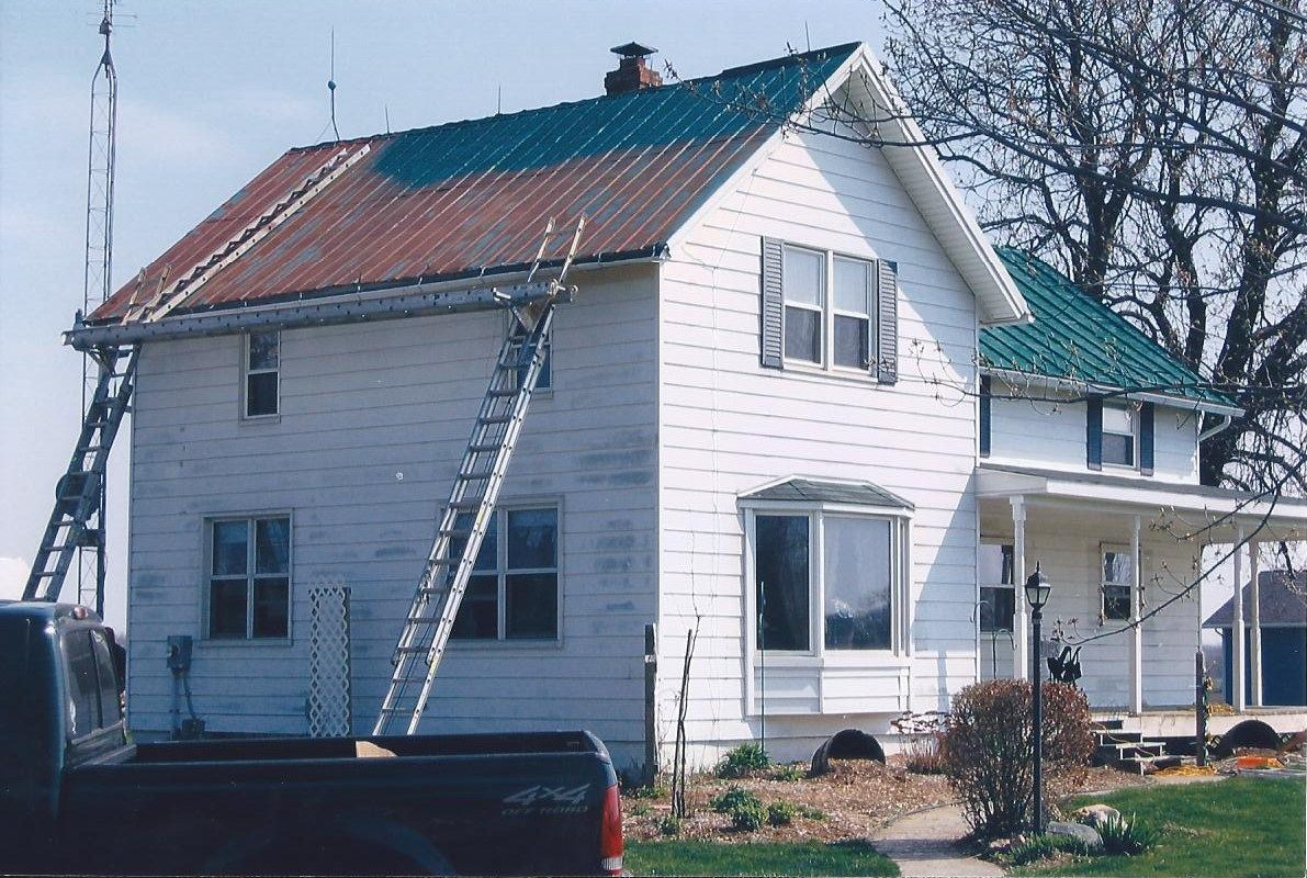 Painting A Metal Roof Painting Houses With Blue Roofs