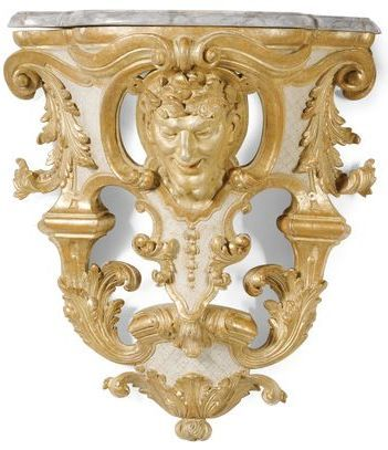 A pair of South German carved giltwood and cream painted wall ...