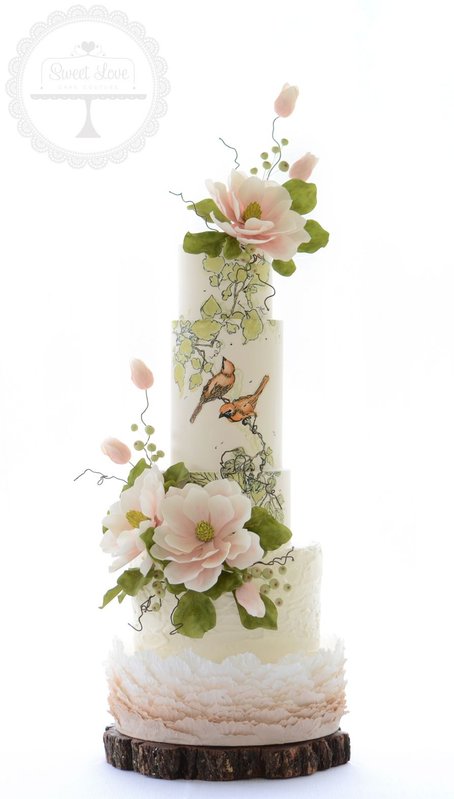 Nature's Love-birds wedding cake with hand painted design and sugar magnolias
