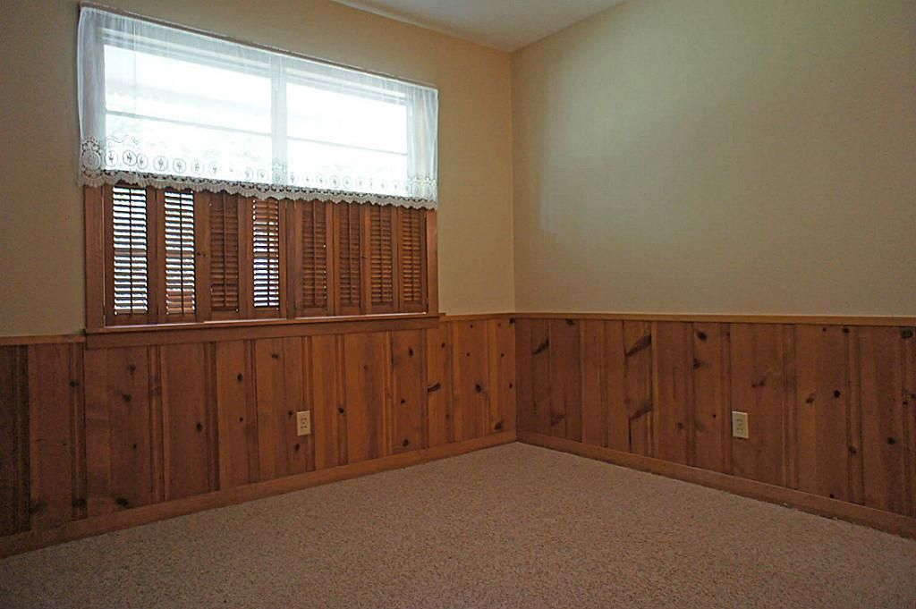 Knotty pine wainscoting basement remodel pinterest for Bedroom with wainscoting ideas