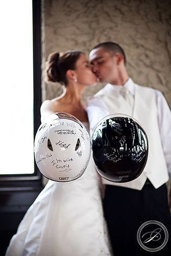 """Have a need for speed? Ask guests to sign your motorcycle helmets, like this couple did. With motorcycle enthusiasts in my own family, this guest book alternative would surely be everyone's top pick, if they could choose. More fun ideas: Have your groom show up to the ceremony by way of a superbike, or opt out of the traditional limo at the end of the night and place a """"Just Married"""" banner on the back of the bike. Talk about riding off in style! Photo by JBailey Photography via The Bridal…"""