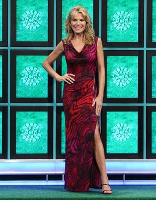 CACHE: Long jersey dress in purple, red, fuchsia, black abstract print, cowl front neckline, sleeveless, gold zipper on left front waist to knee | Vanna White's Dresses | Wheel of Fortune