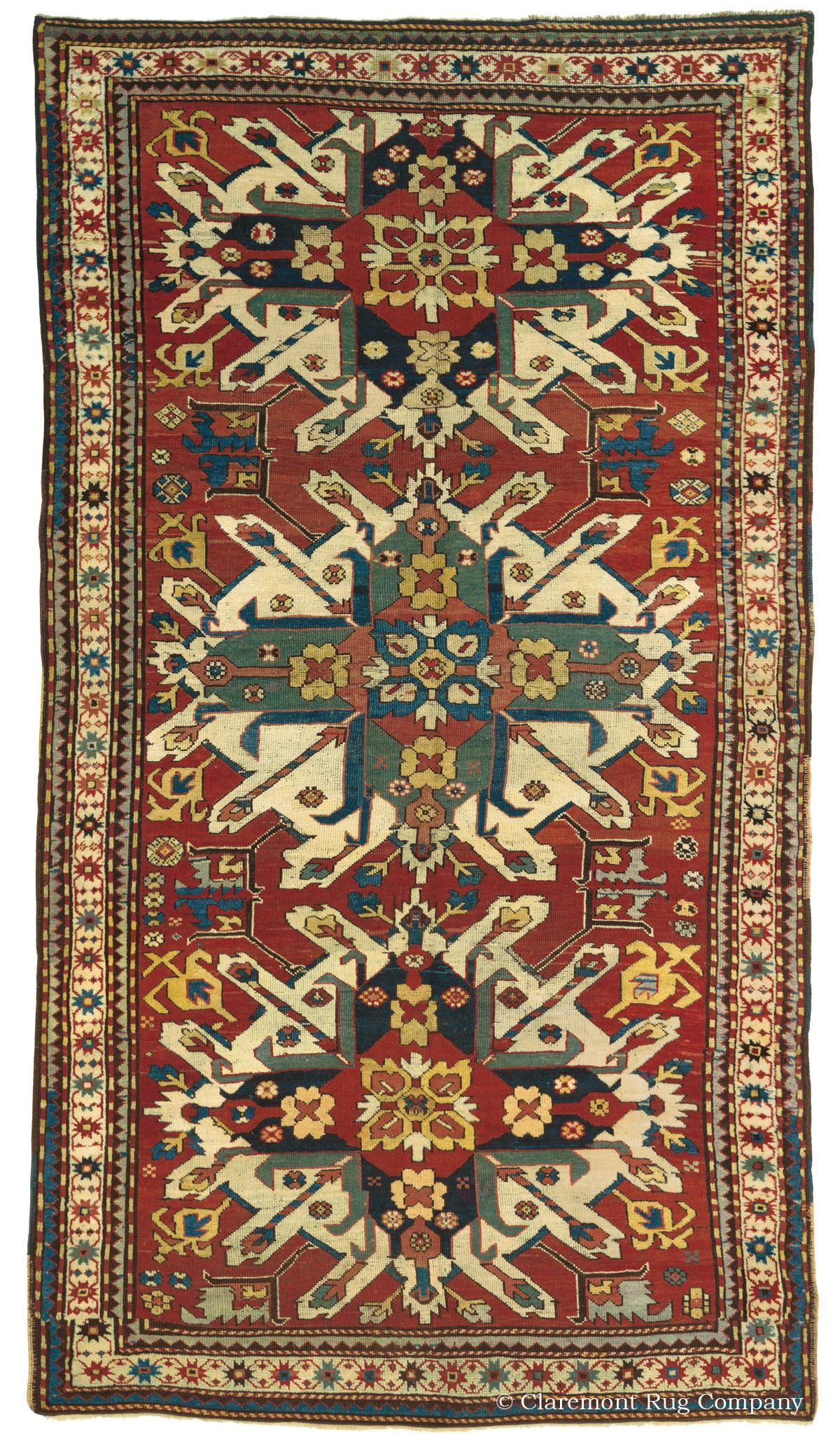 """EAGLE KAZAK (CHELABERD KARABAGH), Southern Central, 4ft 10in x 8ft 8in, Circa 1850. An exceptional, early representative of one of the most illustrious collectible antique Caucasian rug styles, this over-150-year-old Eagle Kazak (Chelaberd Karabagh) rug is truly stunning. In the """"Triple Eagle"""" format, each of its """"sunburst"""" medallions is delightfully asymmetrical and visually expansive."""