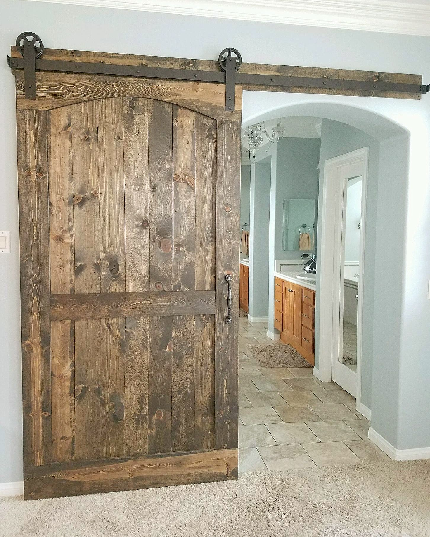 Arched Barn Door With Hardware For A Master Bedroom Bathroom