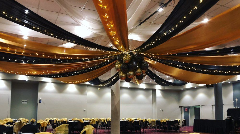 Black And Gold Silk Drapes With Fairy Lights And Balloon Centre By