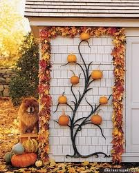 Pumpkins on iron tree.  Dog optional  Autumn decorating ideas