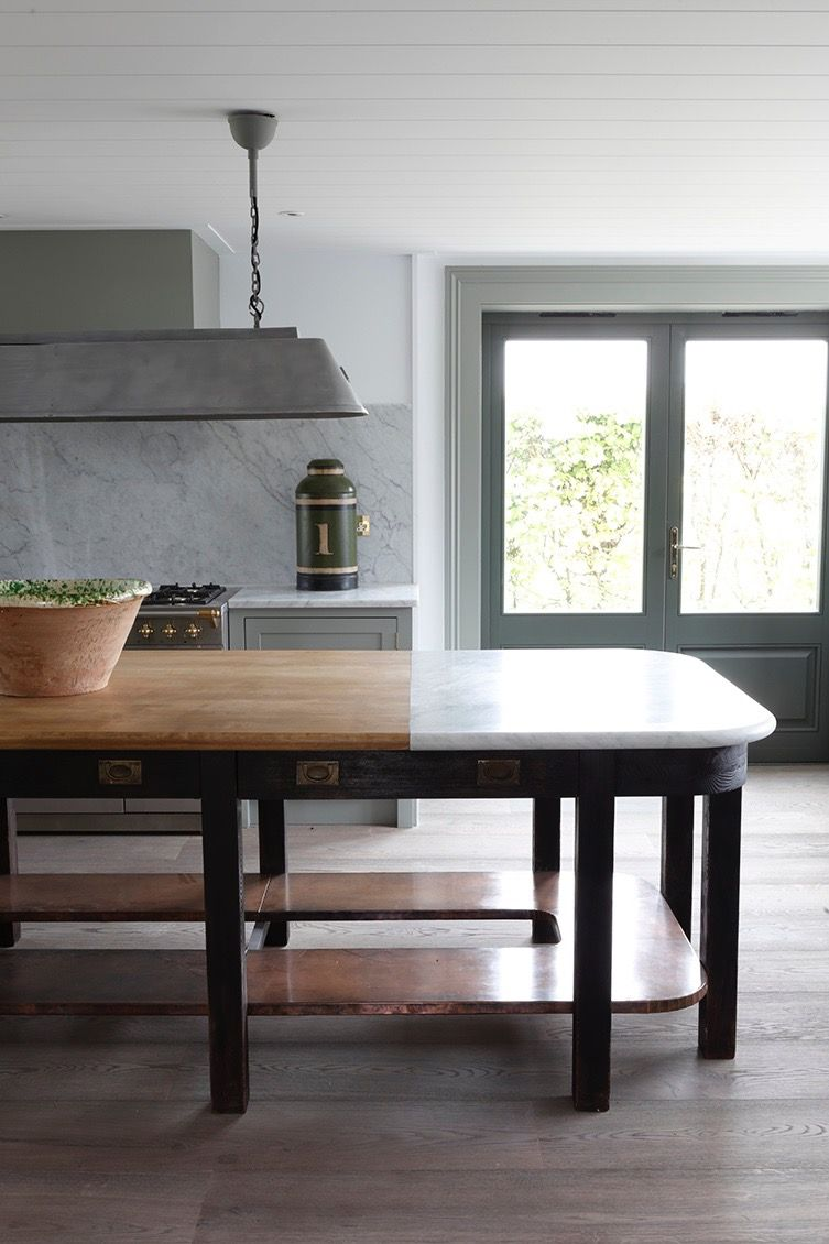 Love this working island with butcher block and marble design by