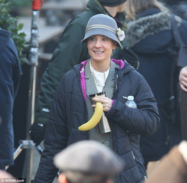 Keeping cosy: Joanne Froggatt was on set as Anna Bates and could be seen keeping warm in a...