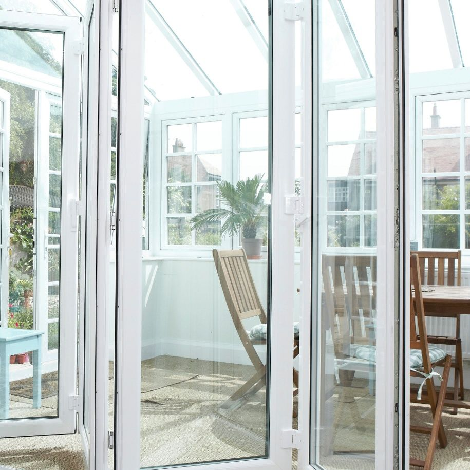 Bi-Fold Doors connecting living room with conservatory | Delightful ...