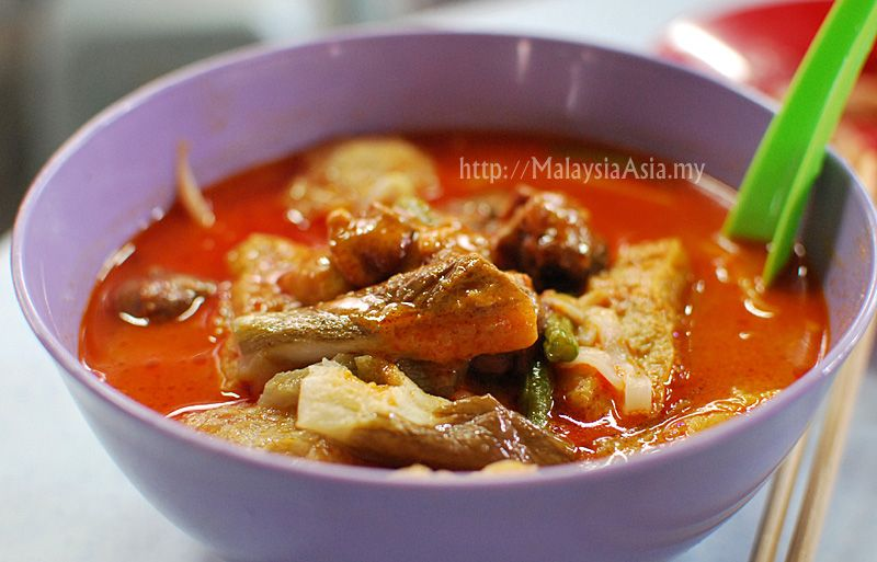 Curry Mee in Malaysia, a spicy coconut infused curry soup with yellow noodles.