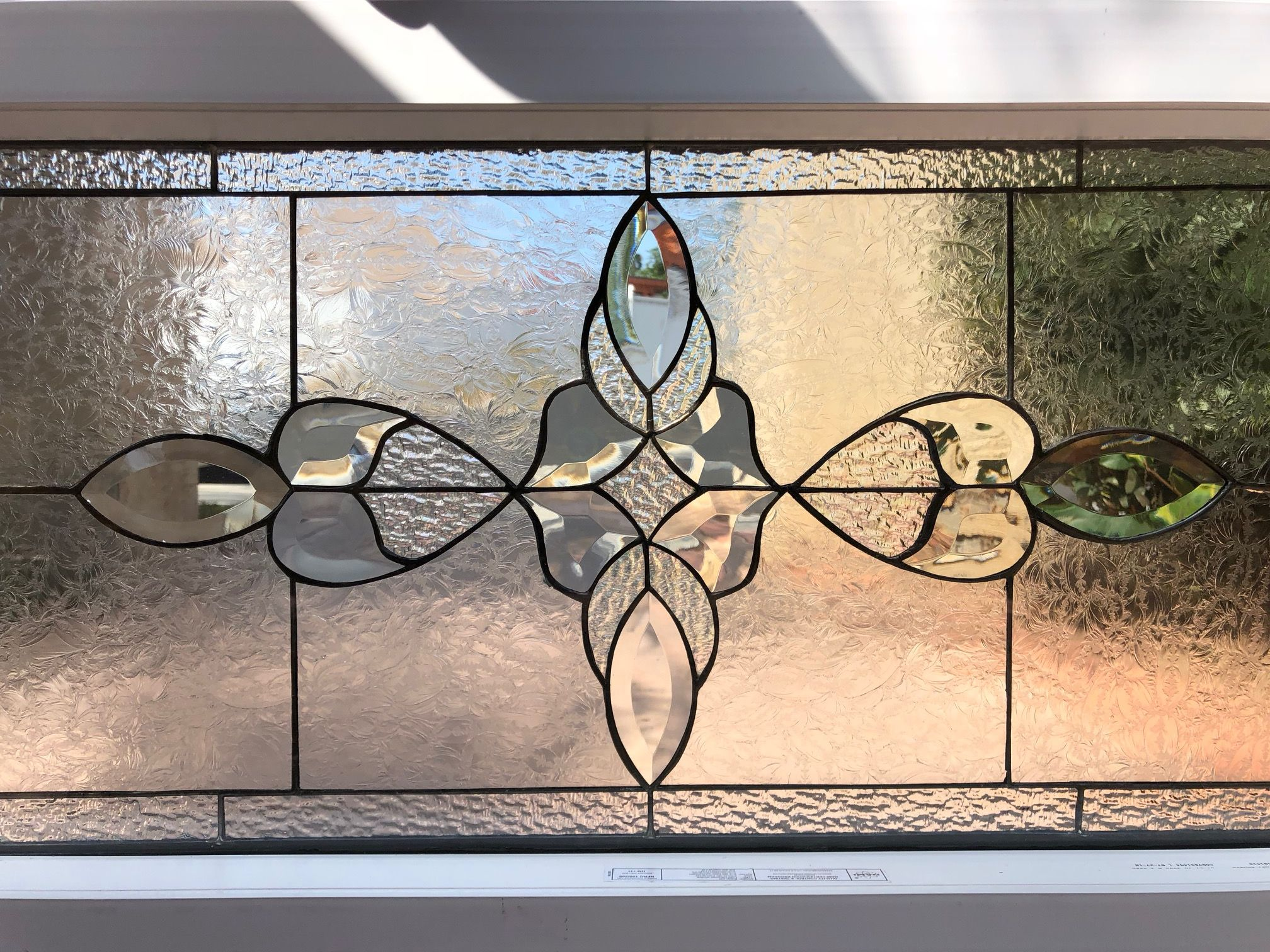 Classic beveled leaded stained glass window insulated in