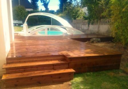 terrasse en bois ( pin, traitée classe 4 ) couleur bronze posée sur