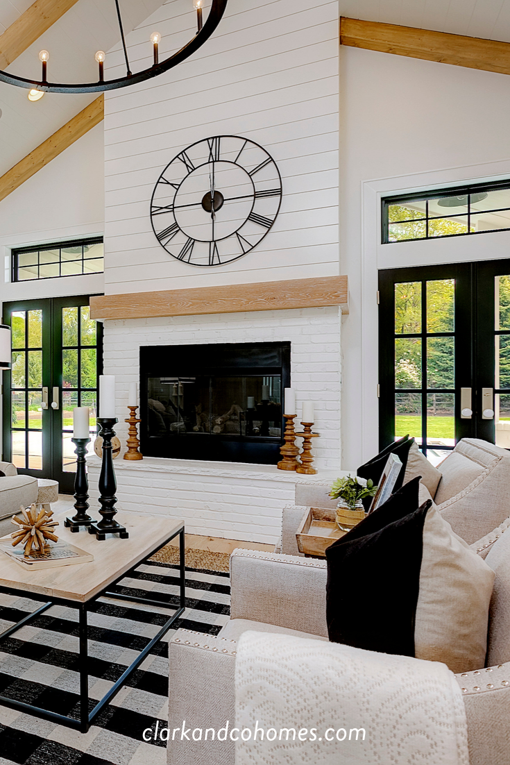 The Great Room In This Modern Farmhouse Home Features A Custom Painted Brick And Shiplap Vaulted Living Rooms Modern Farmhouse Living Room Fireplace Built Ins
