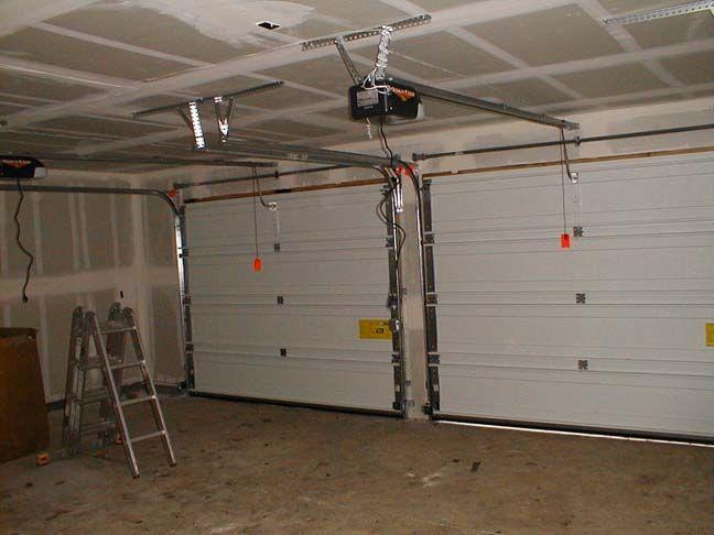 Maintenance Technician Showing Garage Door For Repair Garage Door Opener Installation Garage Door Repair Garage Door Installation