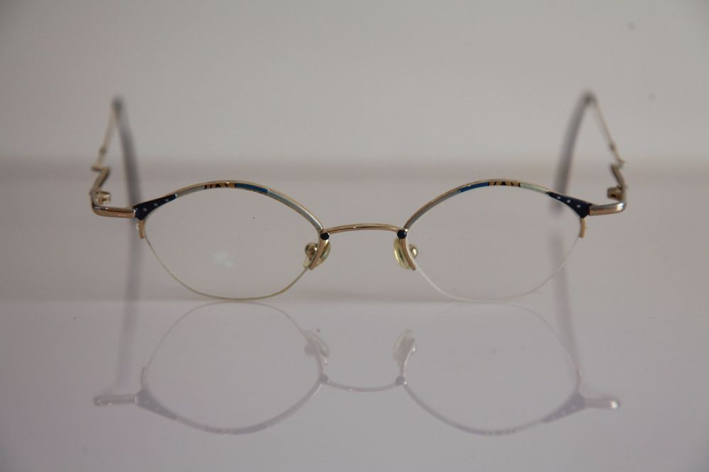 Eyewear,  Gold Half Rimless Frame, Multi-color, RX-Able Prescription Lens.    #Unknown