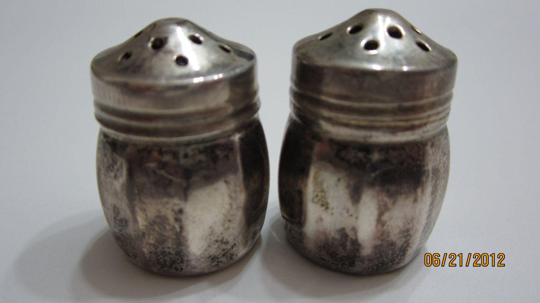 Vintage Salt and Pepper Shakers Sterling Silver. $9.99, via Etsy.