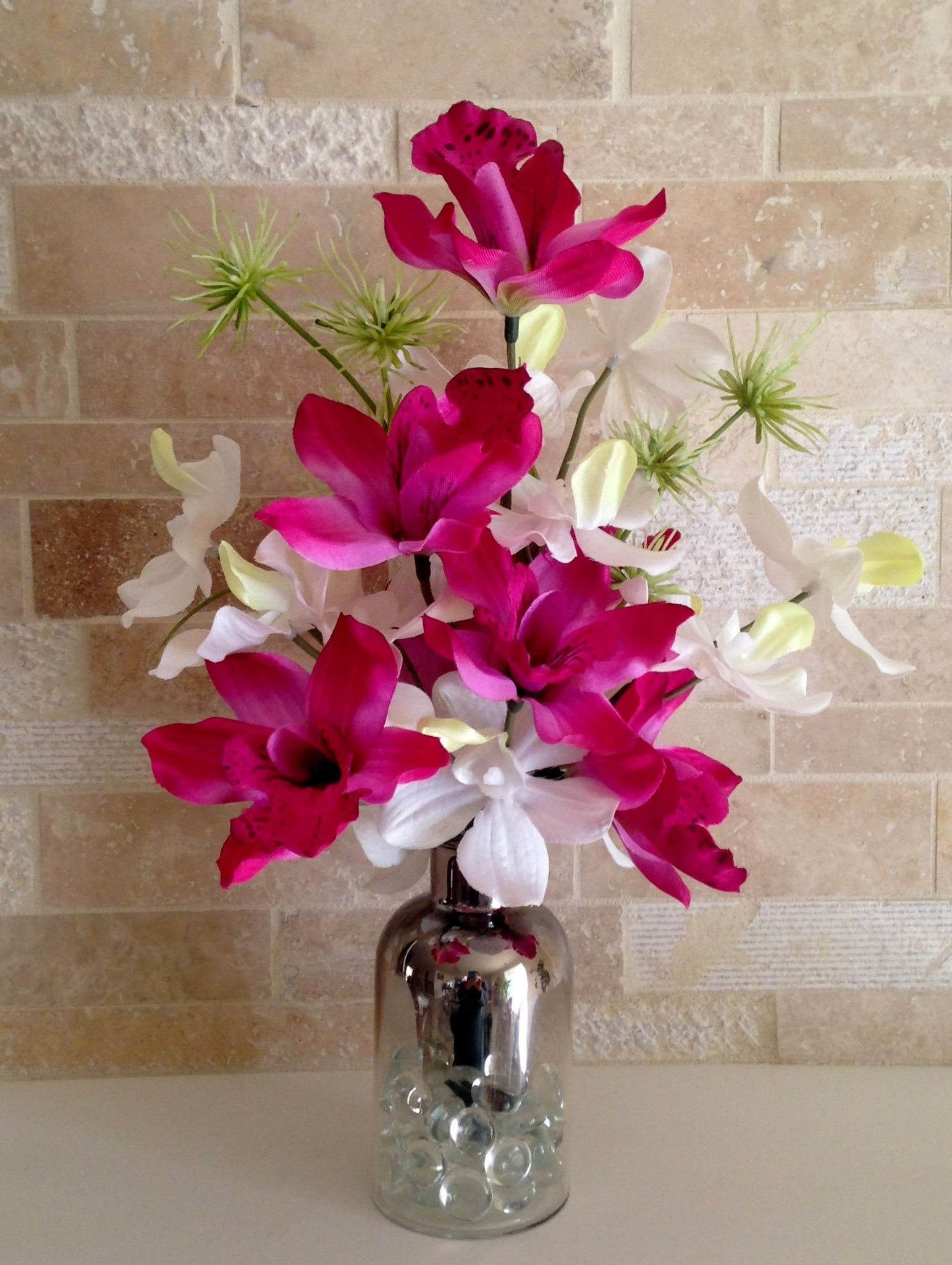 Dendrobium and cymbidium orchid bouquet in mercurydipped ombre