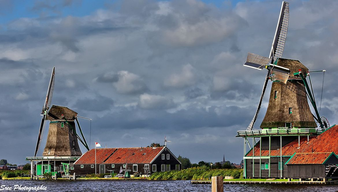 Windmill village of Zaanse Schans, Netherlands. Along the banks of the River Zaan, sit 8 wooden windmills, some still performing traditional functions such as oil, paint and saw milling. Visiting Zaanse Schans gives real insight into the 17th and 18th century Dutch economy and is a wonderful experience for visitors of all ages. #travel-paradise divine, netherlands