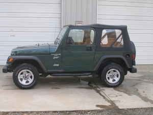Pretty good approximation of what the Jeep looked like. Same color, same year. Dan and I should've gotten one with larger wheels. 1999-2002.