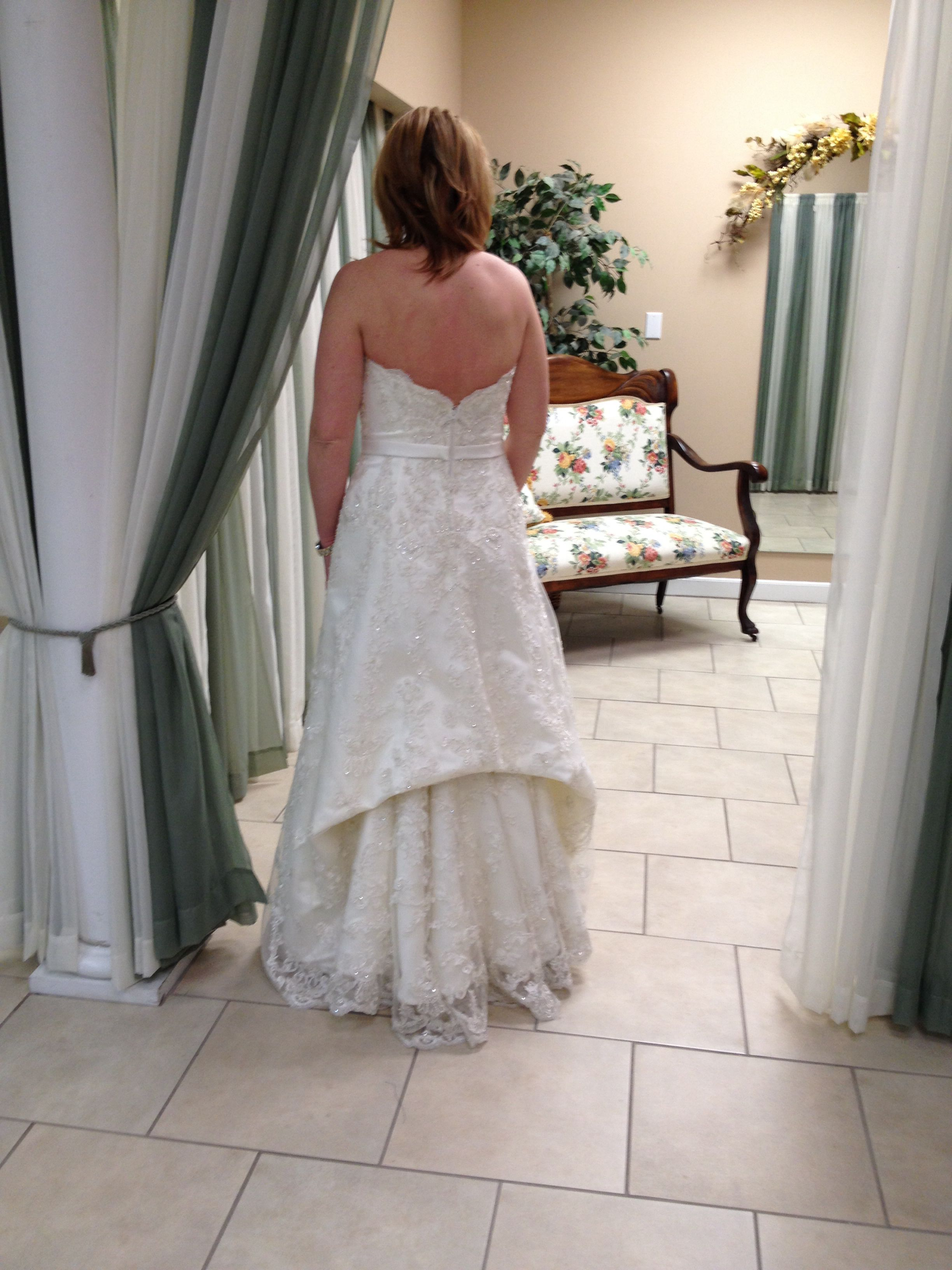 A Traditional French Bustle To Show Off The Lace Scalloped Hem
