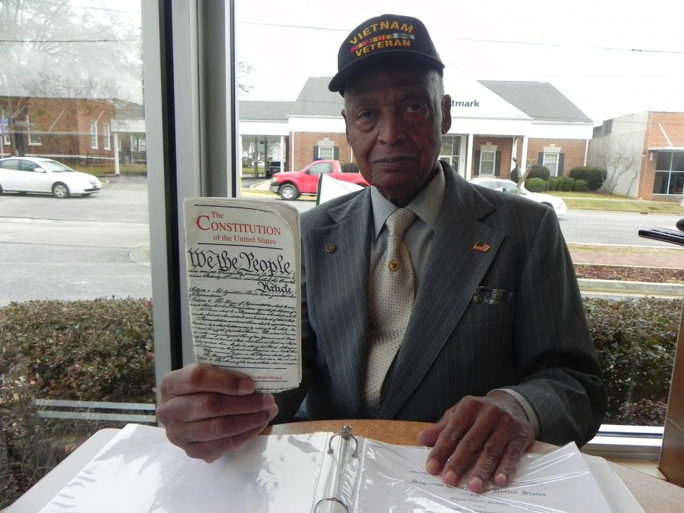 Dr. Earl Cunningham, a plaintiff in the Shelby County Supreme Court case holds up the copy of the Constitution he carries at all times.