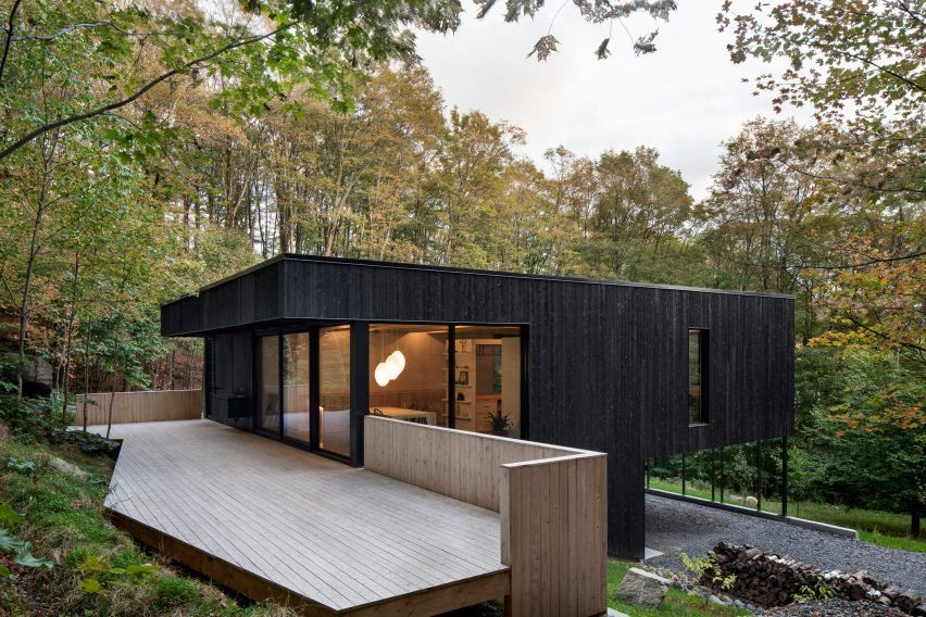 Pilotis Support Black House On Canadian Hillside By