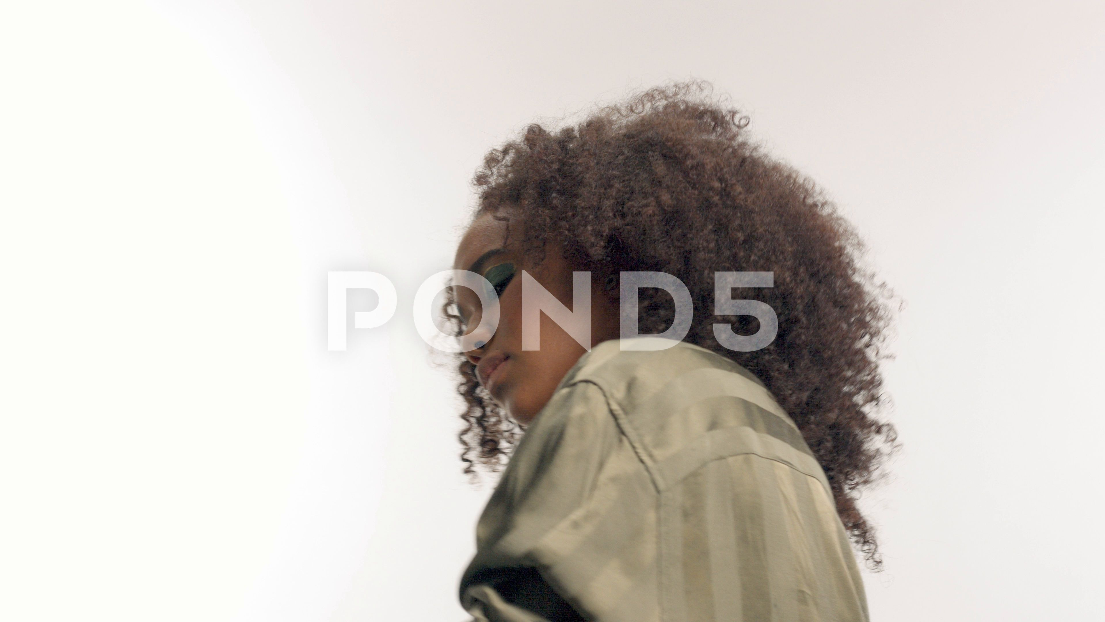 Young Mixed Race Model In Studio On White With Curly Hair Bright Green Eye Stock Footage Ad Model Studio Whi Mixed Race Models Curly Hair Styles Green Eyes