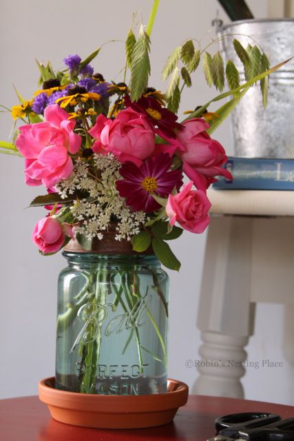 ROBINS NESTING PLACE: Simple mason jar vase with terracotta--my fave on pinterest tin can vases, pinterest crafts vases, fall mason jar vases,