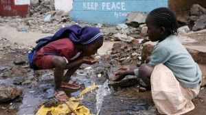 Kids drinking water in the Kibera slum