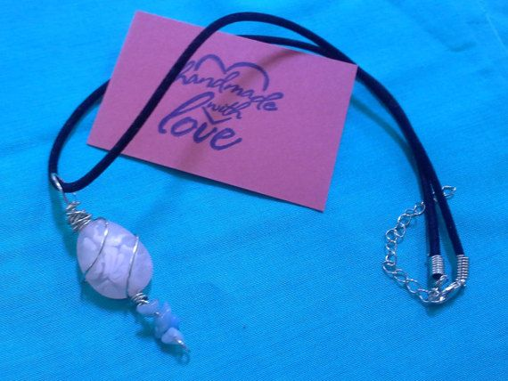 Check out this item in my Etsy shop https://www.etsy.com/listing/242281318/wire-wrapped-pink-stone-pendant-with