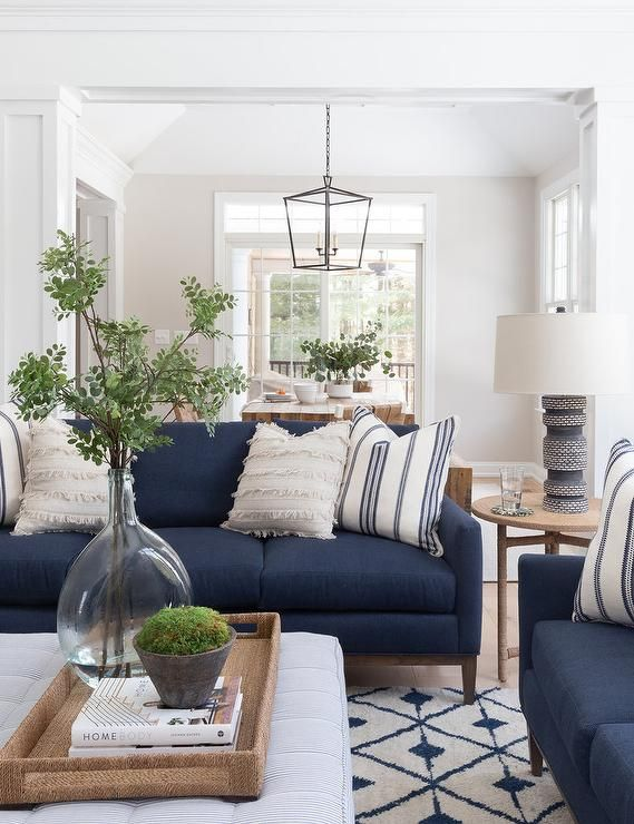 Blue Sofas Accented With White Fringe Pillows Sit In An L Formation On A White And Blue Wool Rug Blue Sofas Living Room Blue Living Room Decor Blue Sofa Living