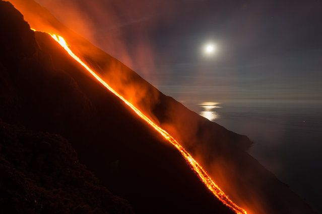 Hot lava trickles down from the Stromboli volcano on August 9, 2014 in Aeolian Islands, Italy. Lava flows down the Mount Stromboli off the Sicilian coast in southern Italy. The volcano – at 3,034ft – is one of the most active in Europe and has been erupting continuously since 1932. (Photo by Tom Pfeiffer/Barcroft Media)