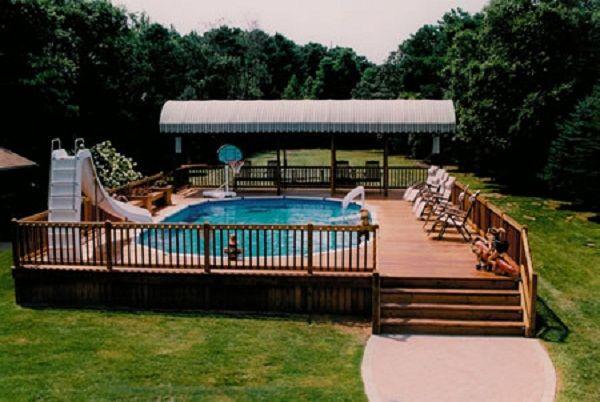 Semi inground pools with green scenery semi inground for Above ground pool half decks