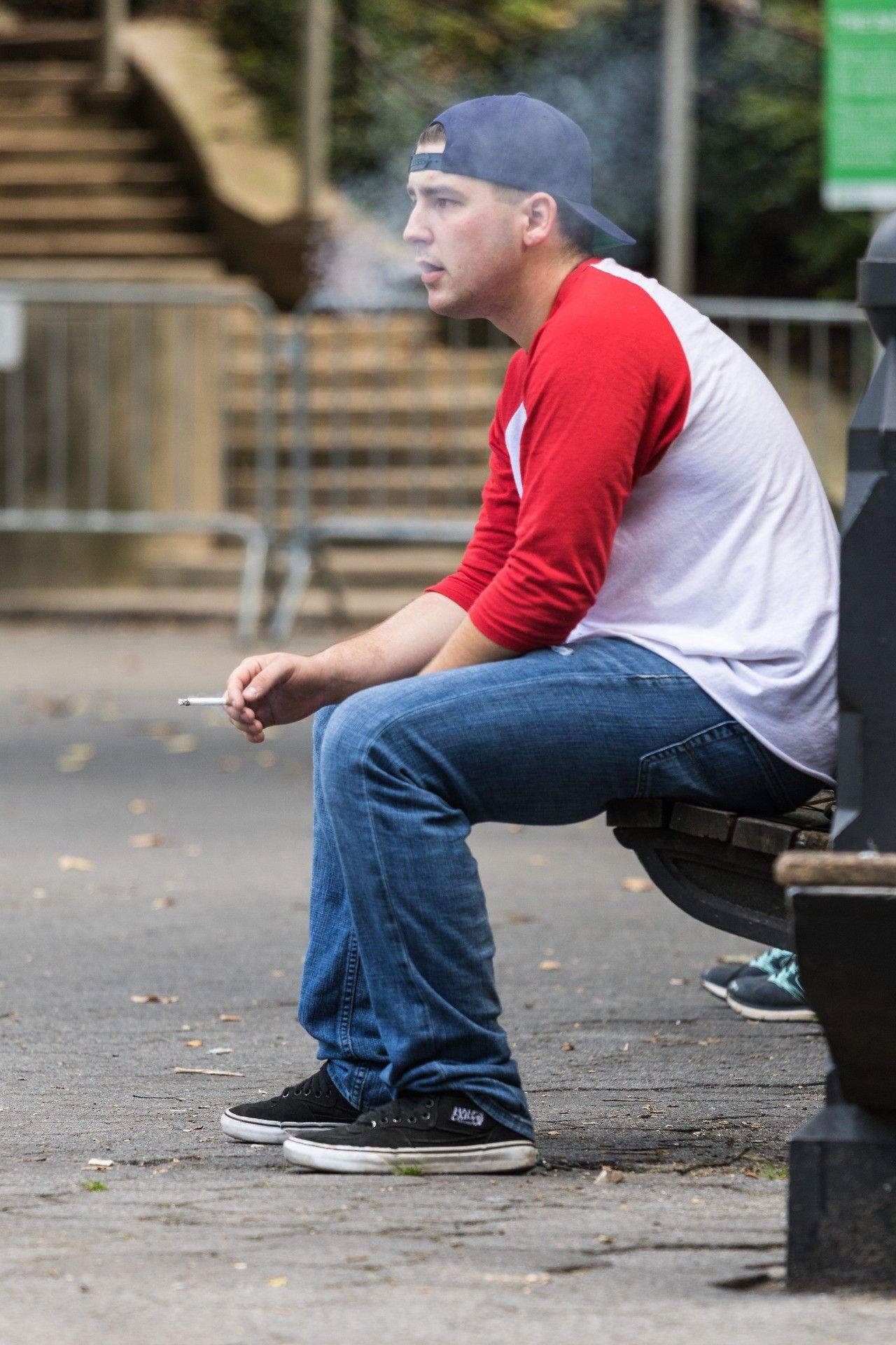 Messy frat man smoking