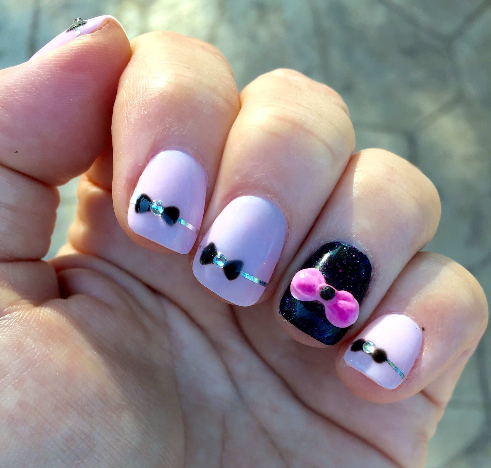 Next Gen nail design - pink and black with a bow and rhinestones. By ...