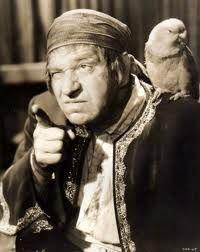 Wallace Beery as Long John Silver Treasure Island