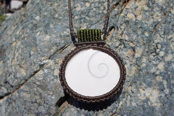 Check out this item in my Etsy shop https://www.etsy.com/listing/525208556/shiva-eye-shell-pendantmacrame