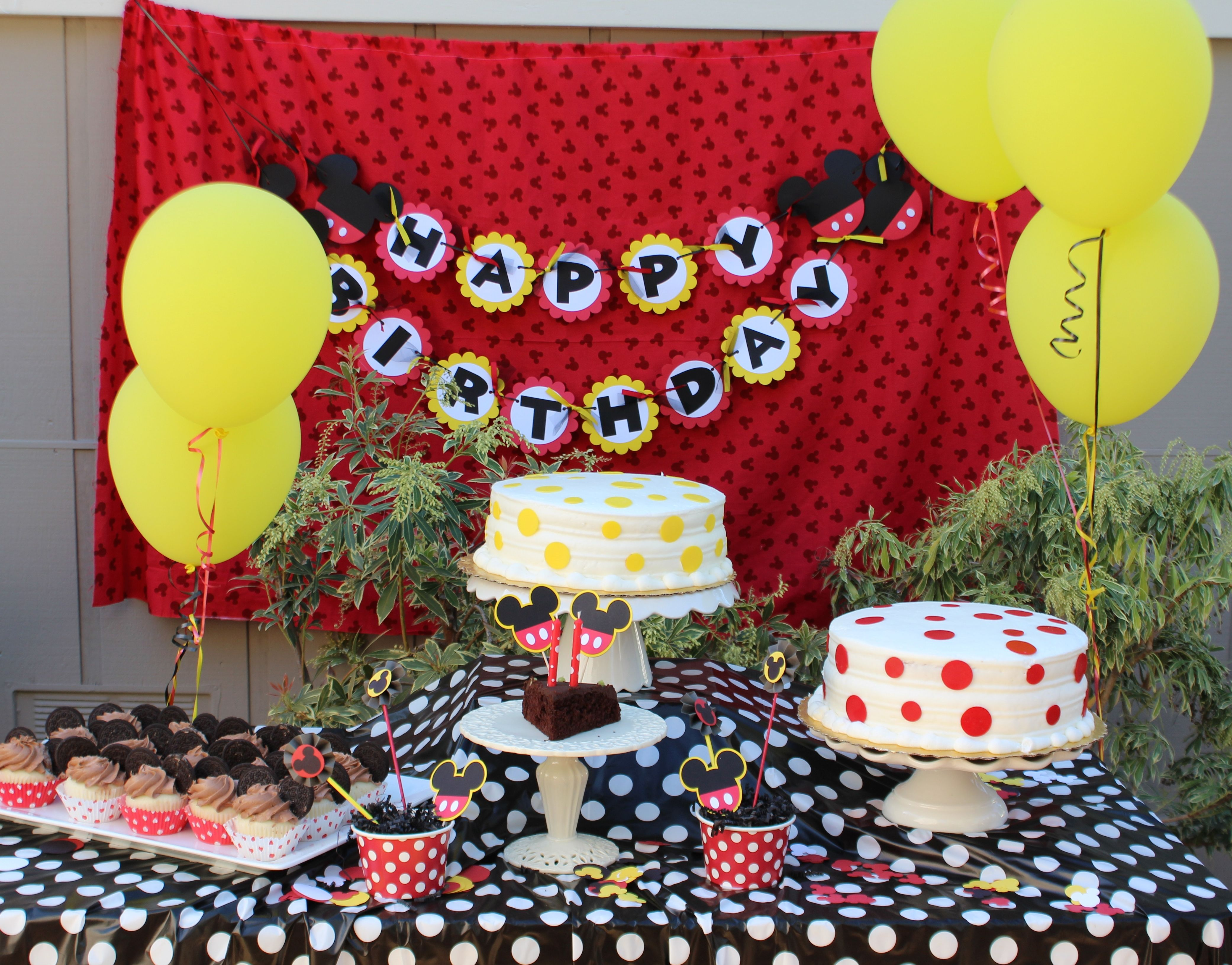 Dessert table for Mickey Mouse clubhouse party White cakes with