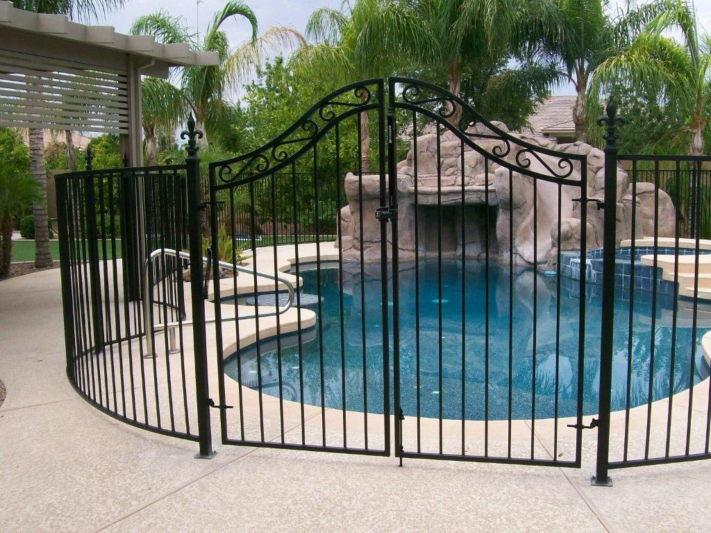 Ugliest Pool Fence Ever With A Little Creativity And Varied Elements Your Pool Doesn T Have To Fence Design Wrought Iron Pool Fence Above Ground Pool Fence