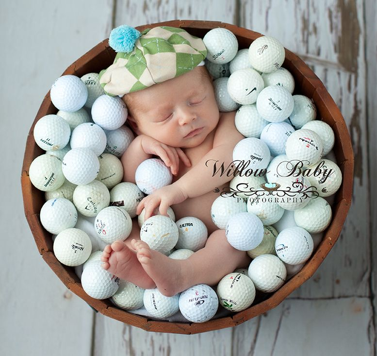 Newborn golf photo of baby in a bucket of golf balls www willowbabyphotography com tee time golf hat newborn baby