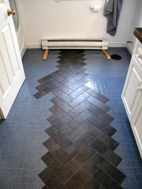 Diy herringbone floor using peel n 39 stick luxury vinyl for Vinyl flooring over vinyl