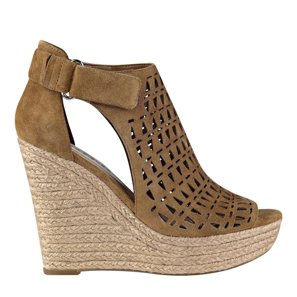 d4fbac987f8c The Helina is an espadrille wedge suede sandal detailed with a laser cut  design